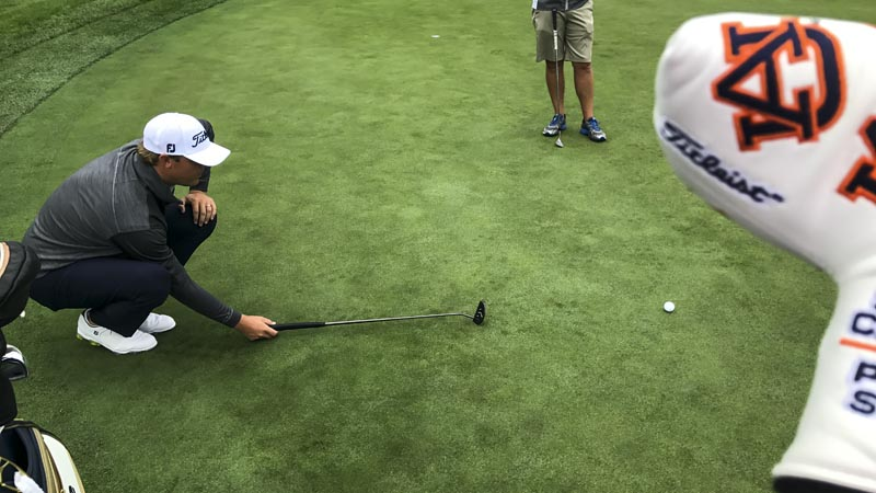 Auburn alum Patton Kizzire on the practice putting surface at TPC Boston.