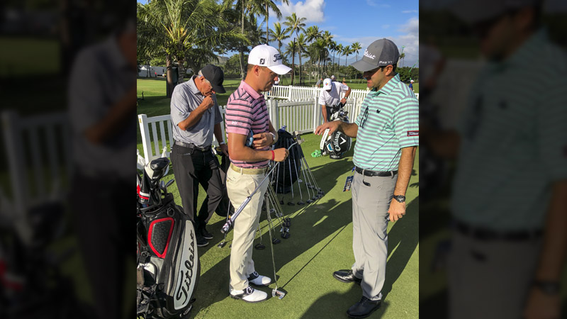 Justin Thomas taking a look at a new prototype mallet.